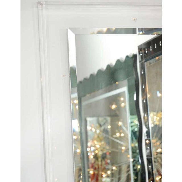 Custom Lucite framed mirror.