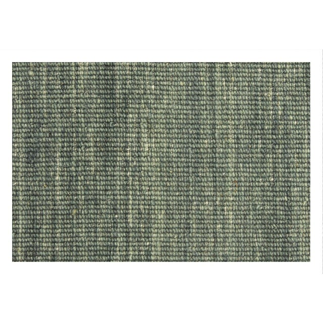 This Indian rug features linear features that exhibit contemporary cores and a rich gradient that reveals a handbook of...