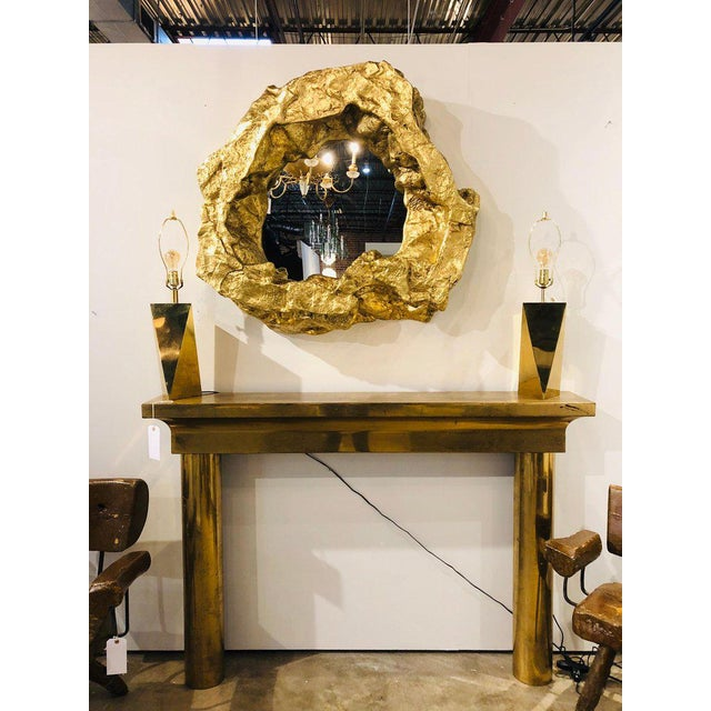 Large modern gold leaf wall mirror. Made of resin.