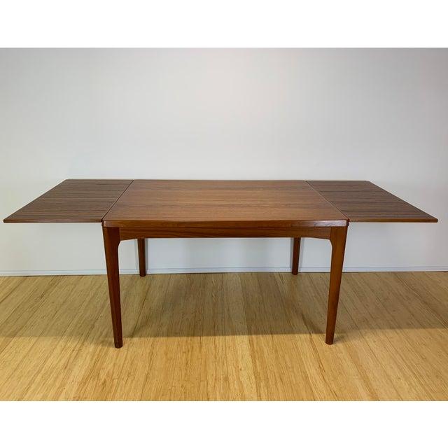Mid century Danish teak dining table designed by Henning Kaerjnulf for Vejle Stole & Møbelfabrik circa the 1960-70's....