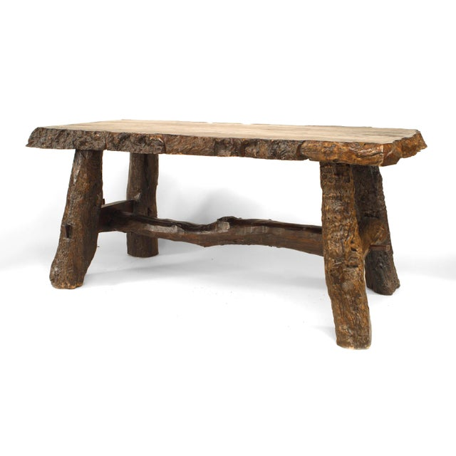 Rustic American Adirondack style 20th century walnut rectangular top dining table with bark trim edge and tree trunk from...