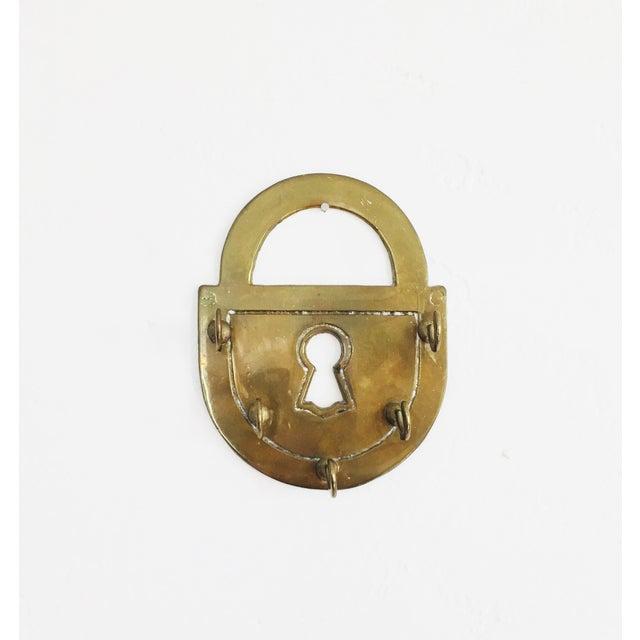 A lovely vintage brass lock shaped key rack.