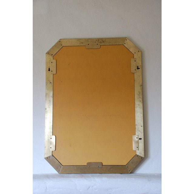 French 70's octogonal brass mirror by Guy Lefevre