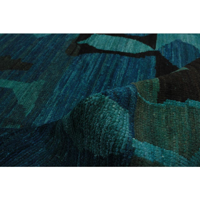 This is a vintage rug that was hand-knotted in Morocco. Country of Origin: Morrocco Style of the rug :Abstract...