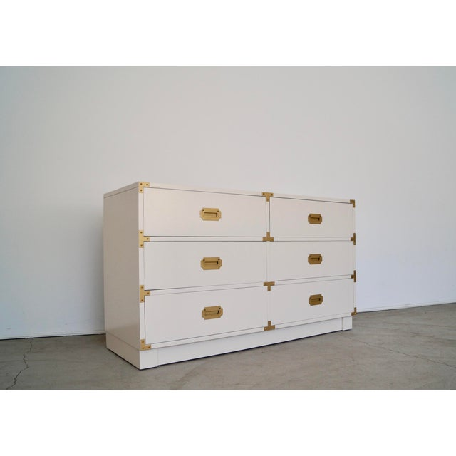 We have this gorgeous original vintage Mid-century campaign dresser for sale. It was manufactured in 1965 by the high-end...
