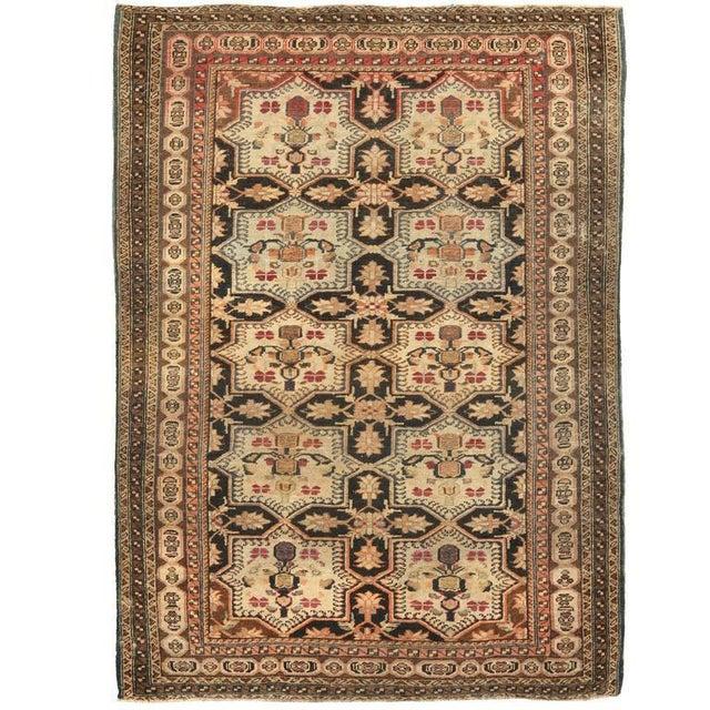 Antique Persian village rug. Contact dealer.