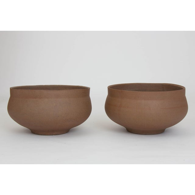 A pair of ceramic bowl planters from David Cressey's Pro/Artisan collection for Architectural Pottery. The unglazed...