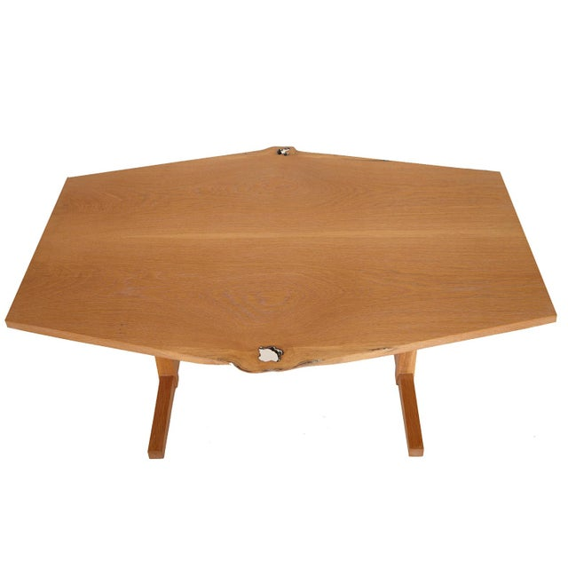 Solid oak Tivoli coffee table by New York heartwoods. Live edge top detail made from sustainable Hudson Valley trees....