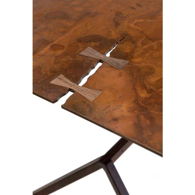 Hewed from 1/4 blackened steel with solid wood details, the Steel Forest Dining is a statement piece for your space. The...