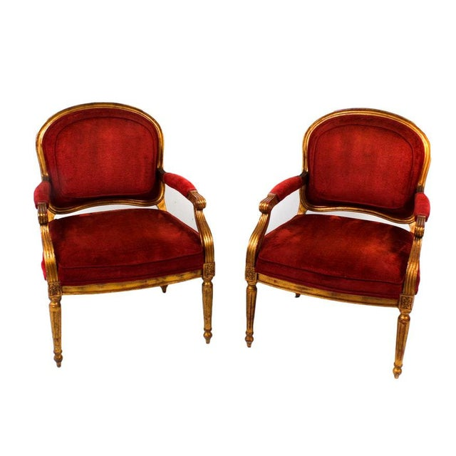 A Beautiful set of 4 red velvet chenille upholstered bergere armchairs by Beverly Furniture. Each features a gilt finished...