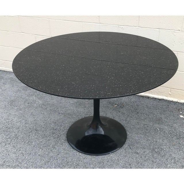 Unique sparkling black marble dining room table excellent condition. Made in the 1980s.