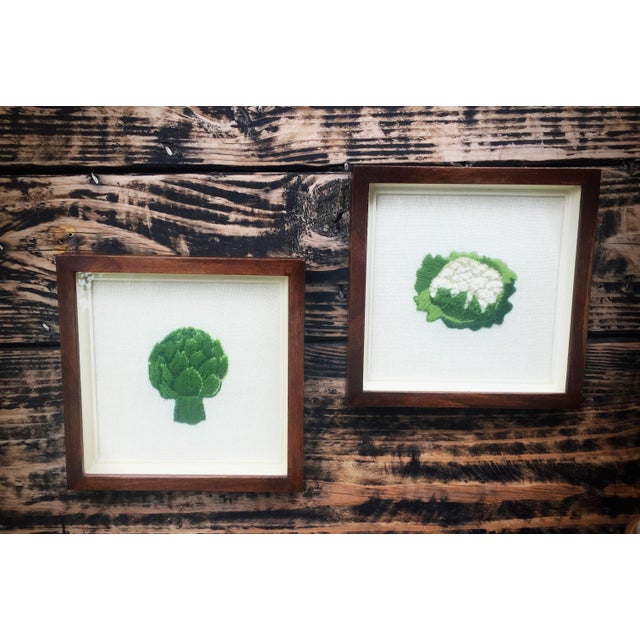 This set of vintage crewel pictures of artichoke and cauliflower have been beautifully framed in a shadow box frame with...