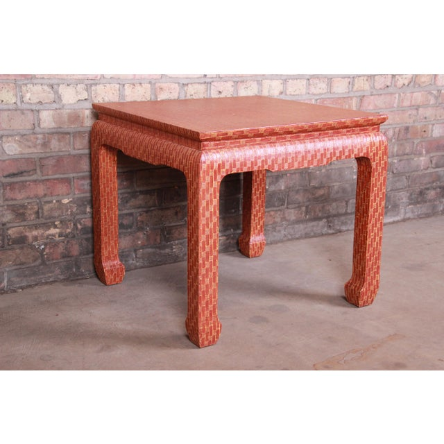 A gorgeous mid-century modern Hollywood Regency Chinoiserie red lacquered grass cloth side table By Baker Furniture USA,...