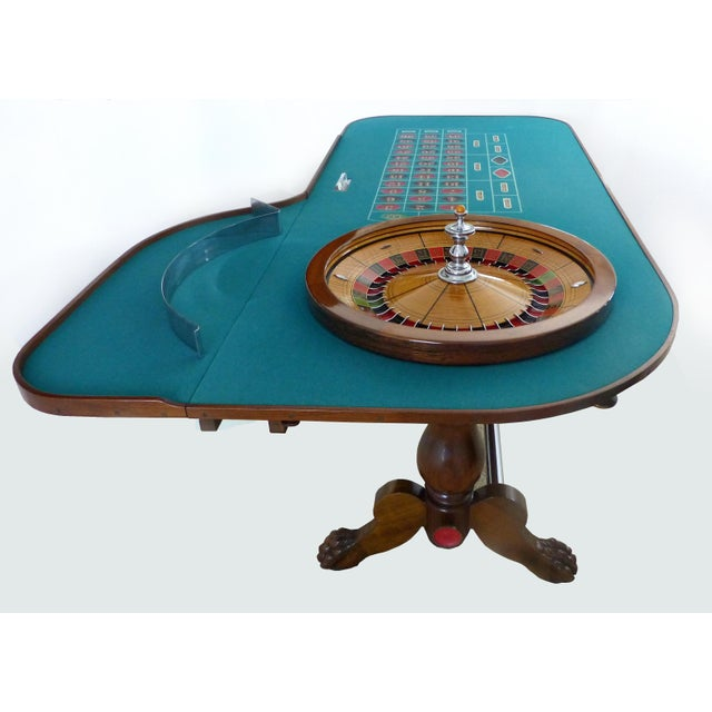 Offered for sale is a magnificent hand carved mahogany Roulette table which was used at the world famous O'DWYER'S Casino...