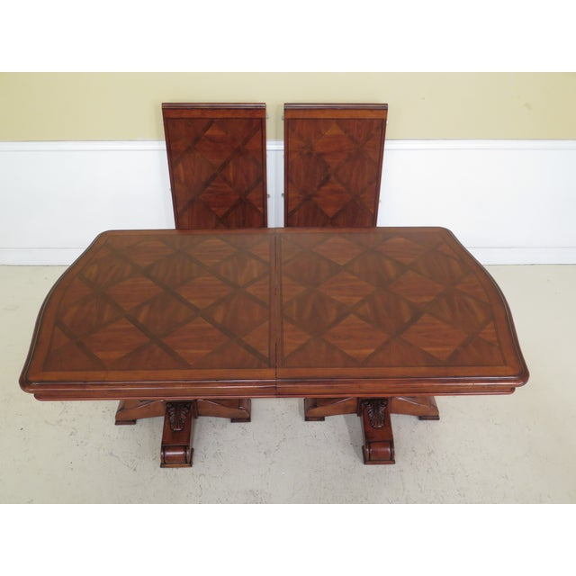 Ethan Allen Tuscany collection walnut finish dining table. Features quality construction, walnut finish and 2-24 inch leaves.