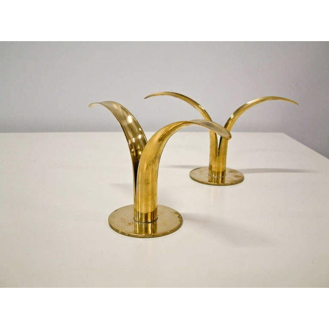 Sweden Circa 1950 A dramatic grouping of brass lily form candleholders made in Sweden of two varing heights. Each...