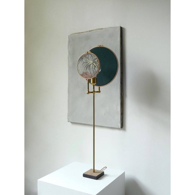 Light object, floor lamp, circle blue grey Handmade in brass, leather, wood, hand printed and painted linen. A dimmer is...