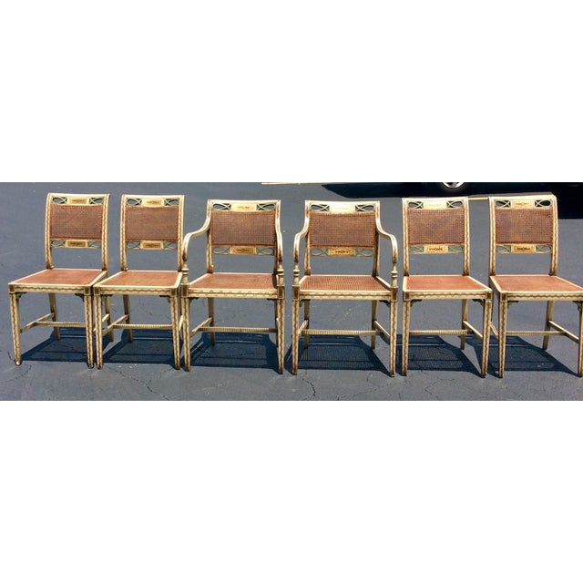 Set of 6 Unique Country French design with classical decoration dining chairs. The chairs have wicker back and seat....