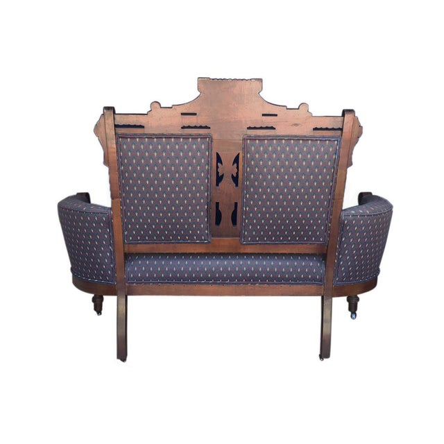 Vintage Victorian inspired settee on casters, with beautiful carved wood details.
