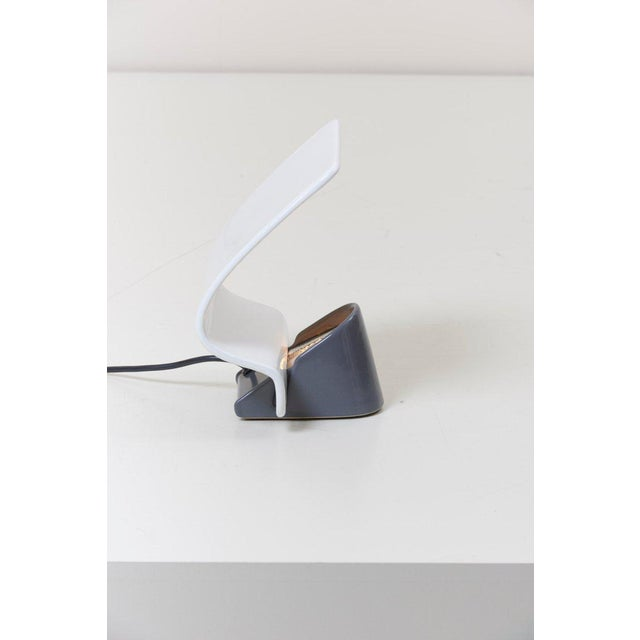 Italian table lamp with curved reflector in white and grey ceramic. To be on the safe side, the lamp should be checked...
