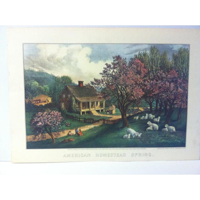 """This is a reproduction of a Currier & Ives color print that is titled """"American Homestead - Sprint 1869"""". The print is..."""