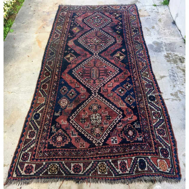 Hand knotted with vegetable dyed wool, from the 1870s From the nomadic Afshar weavers, this runner from circa 1890 is...