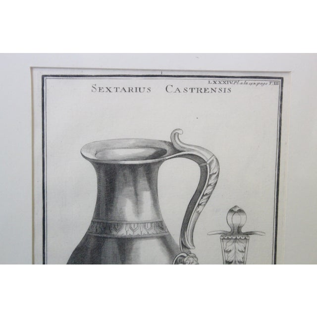 """Engraving in black and white of a Greek vase and human motifs. On white matte. Titled """"Urns and Vases of ancient Times""""...."""