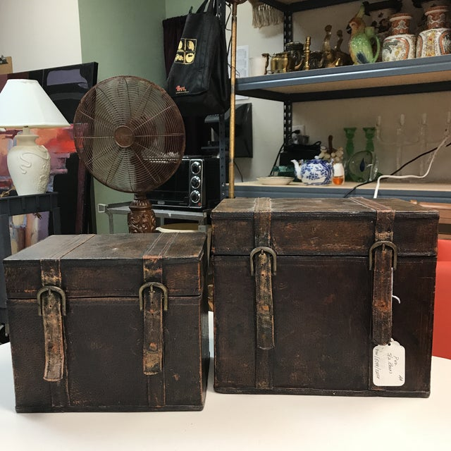 Gorgeous pair of vintage leather boxes. The smaller fits inside the larger. Exquisitely detailed. Great craftsmanship....