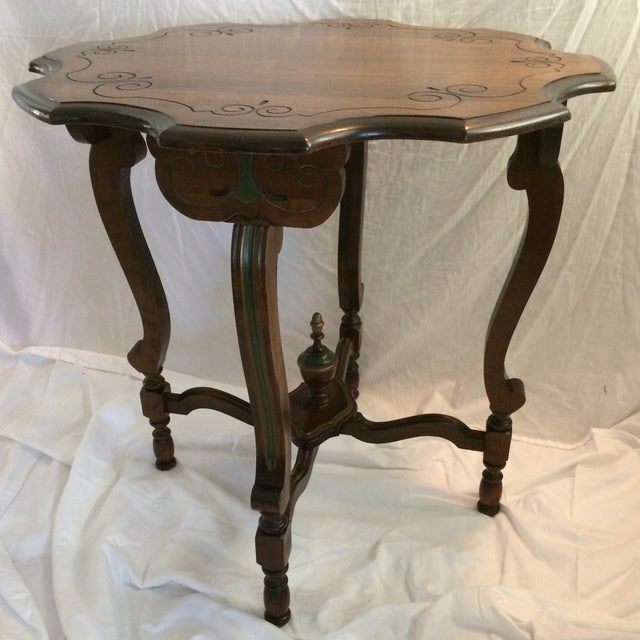 Very detailed Aesthetics Movement table with recessed scroll carving in the mahogany wood top. Beautiful grain. Legs and...