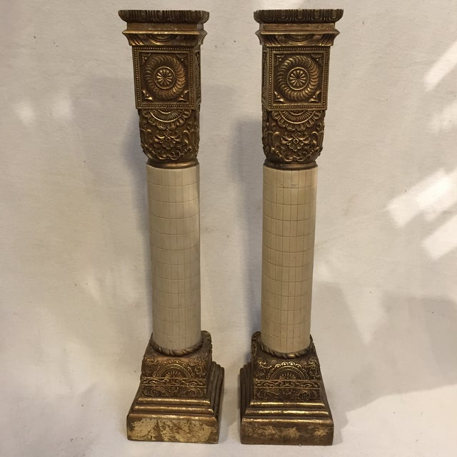 Very large candle holder pair made in the style of antique columns. The gold highlights make these stand out! Looks like...