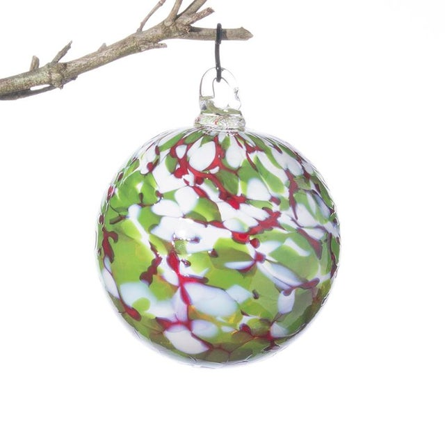Handmade in Asheville, NC, this festive set of one-of-a-kind glass ornaments will look beautiful as a decoration on the...