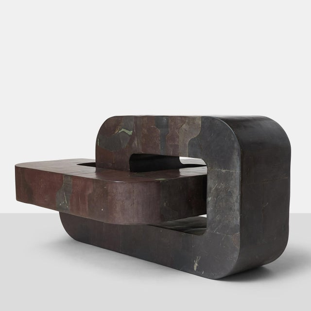 A unique coffee table or sculpture by Pierre-Elie Gardette made of slate marquetry which creates an overall design. The...