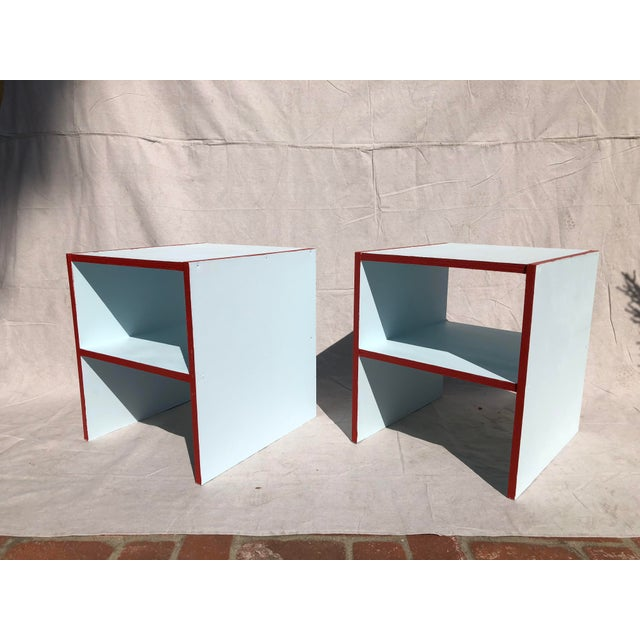 Hand made, hand painted pair of night stands in sky blue with red outlines.