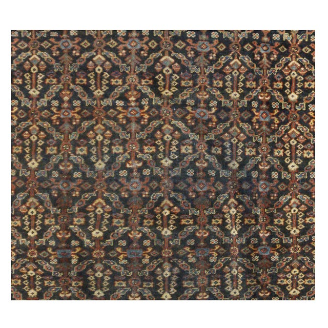 This beautiful rug is hand made, 100% wool-pile,made in Iran. It features a pattern in a vibrant combination of red,...