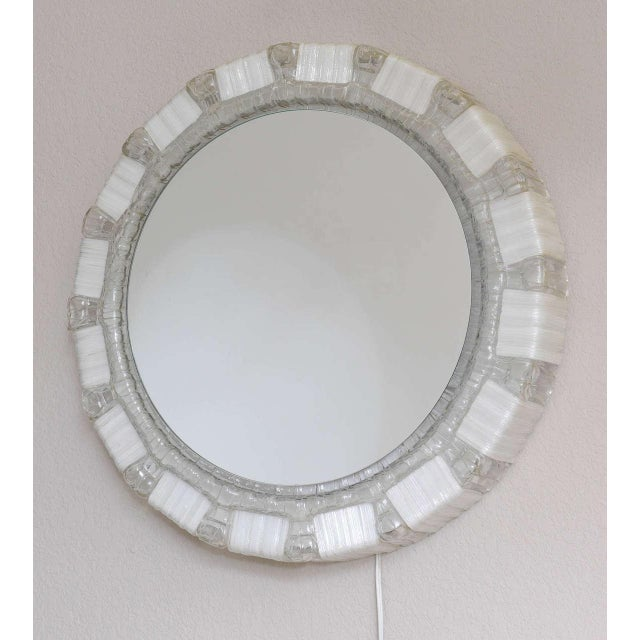 Unusual German backlit mirrors in crackled clear and white resin, circa 1970. Priced per item, 2 available.