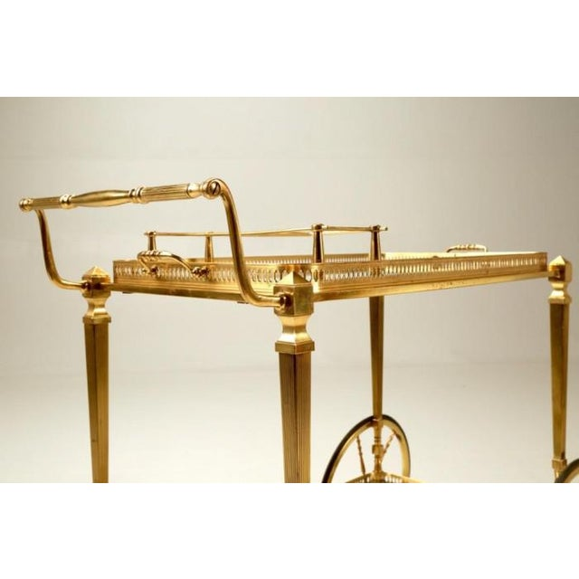 Vintage French brass tea or bar cart, probably made around the 1960's. Convenient removable tray with handles. There are...