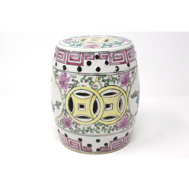 A vintage ceramic garden stool, hand painted with pink and yellow designs and flowers. Good vintage condition; there are a...