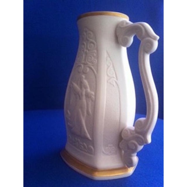 This Lenox Pitcher, #352 of a Limited Edition of 5,000, with the beautifully embossed forms of Romeo & Juliet on both...