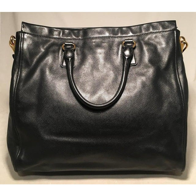 Prada Black Leather Saffiano Top Handle Tote Shoulder Bag in excellent condition. Black leather exterior trimmed with gold...