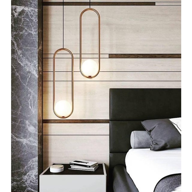 A labour of love, Mila 7 chandelier or pendant was realized through the marriage of hand blown glass and the soft geometry...