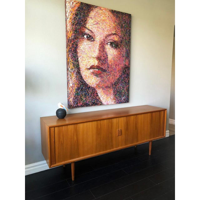 A stunning design, this solid, very large tambour door credenza was designed by Svend Aage Larsen for Faarup Mobelfabrik...