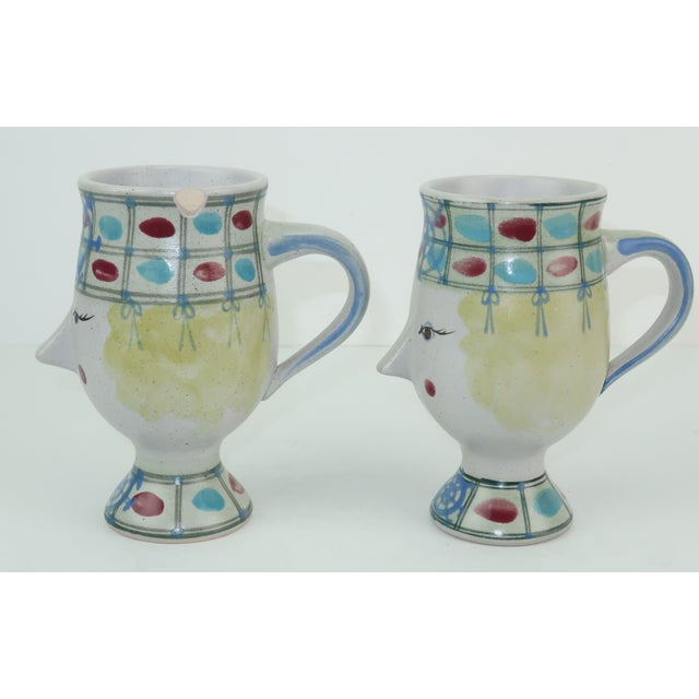 Two is better than one...especially when it comes to these whimsical Fitz & Floyd pottery mugs! The charming mugs are...