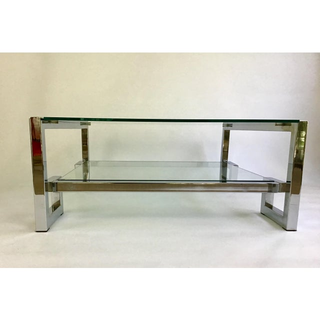 From a Charleston estate, a fabulous mid century chrome Greek key coffee table. Two layers of thick glass expands...