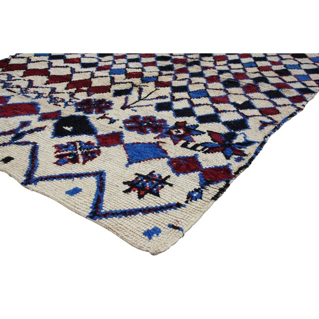 One-of-a-kind Moroccan rug handwoven by the Berbers of the Atlas Mountains. The natural colors and abstract design...