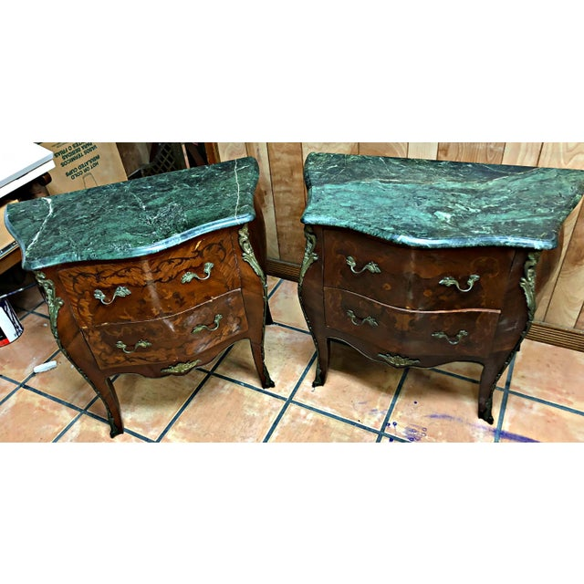 Pair of French Louis XV-style pair of commodes or bombe chests of drawers, with serpentine shape, green marble-top above...