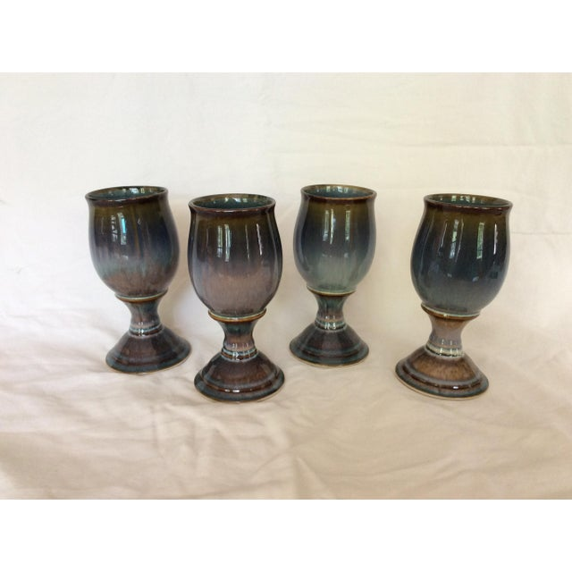 Offered are four glazed goblets. Glazing is exquisite.