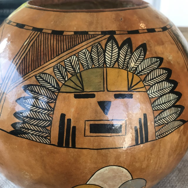 Beautiful hand painted natural gourd. Motif is a Hopi Sunface. Signed by Linda. From an art collector's estate in Santa...