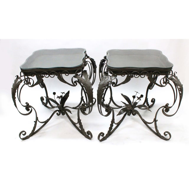 Beautiful and detailed Iron Bent Floral Tables with stop custom cut glass, that lays on top. The top has space between the...