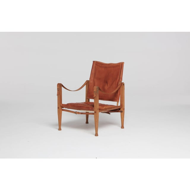An authentic vintage Kaare Klint safari chairs in beautifully patinated tan leather. Designed in 1933 and produced by Rud...