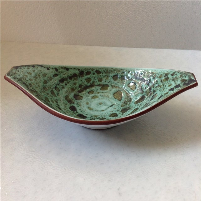 Vintage ceramic art pottery bowl. Features a textured glaze in shades of green. Made in Norway.